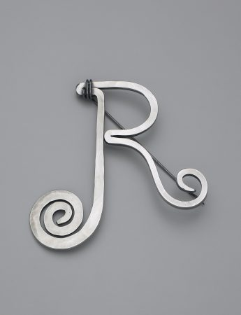 JR brooch (c. 1940)